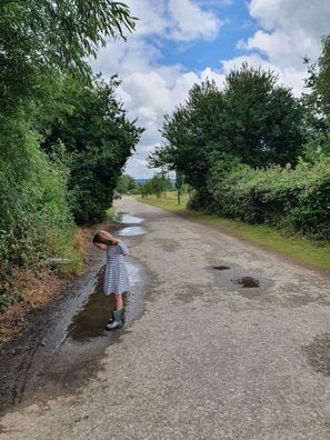 Girl standing over puddle in Leybourne Lakes