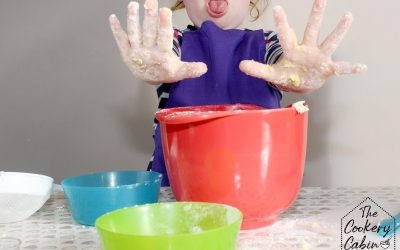 Child baking with messy hands