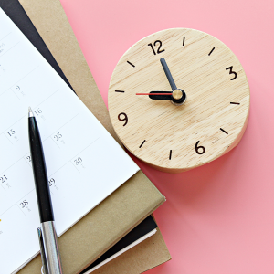 Calendar and a clock with pink background