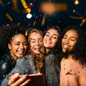 Party image four girls smiling taking a selfie